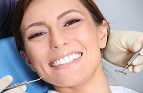 Woman smiling during dental treatment