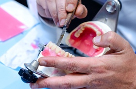 technician working on dentures