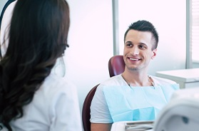 middle-aged man talking to dentist