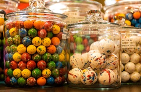 jars full of colorful jawbreaker candies at candy store